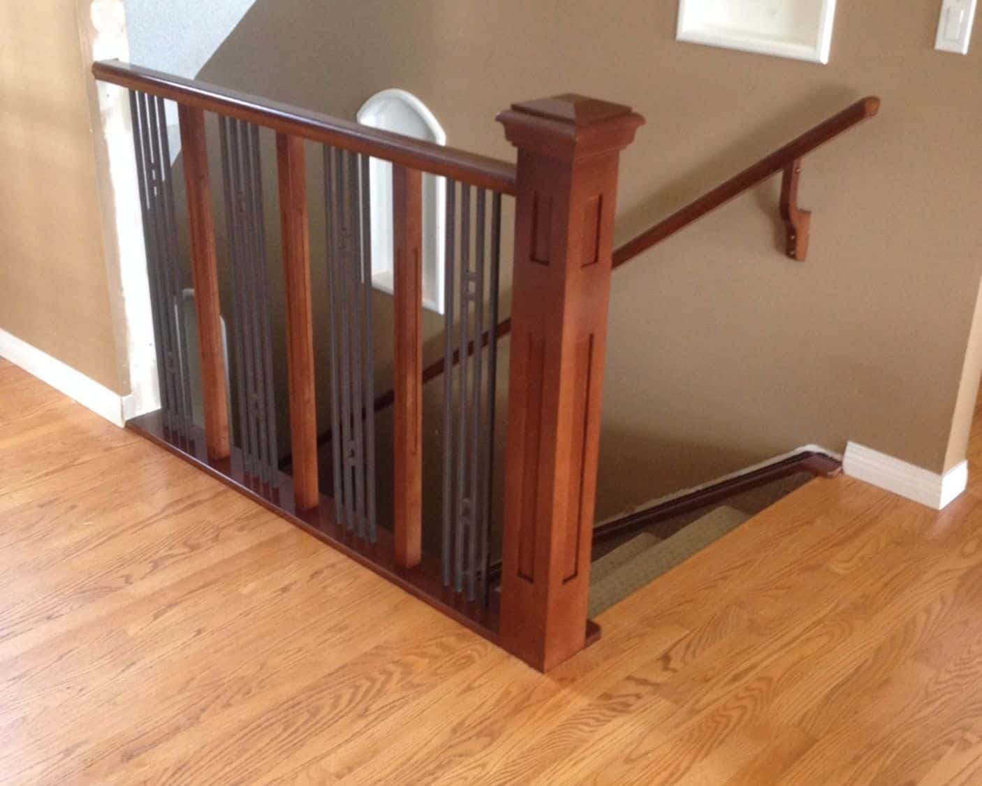 Stained maple railing after
