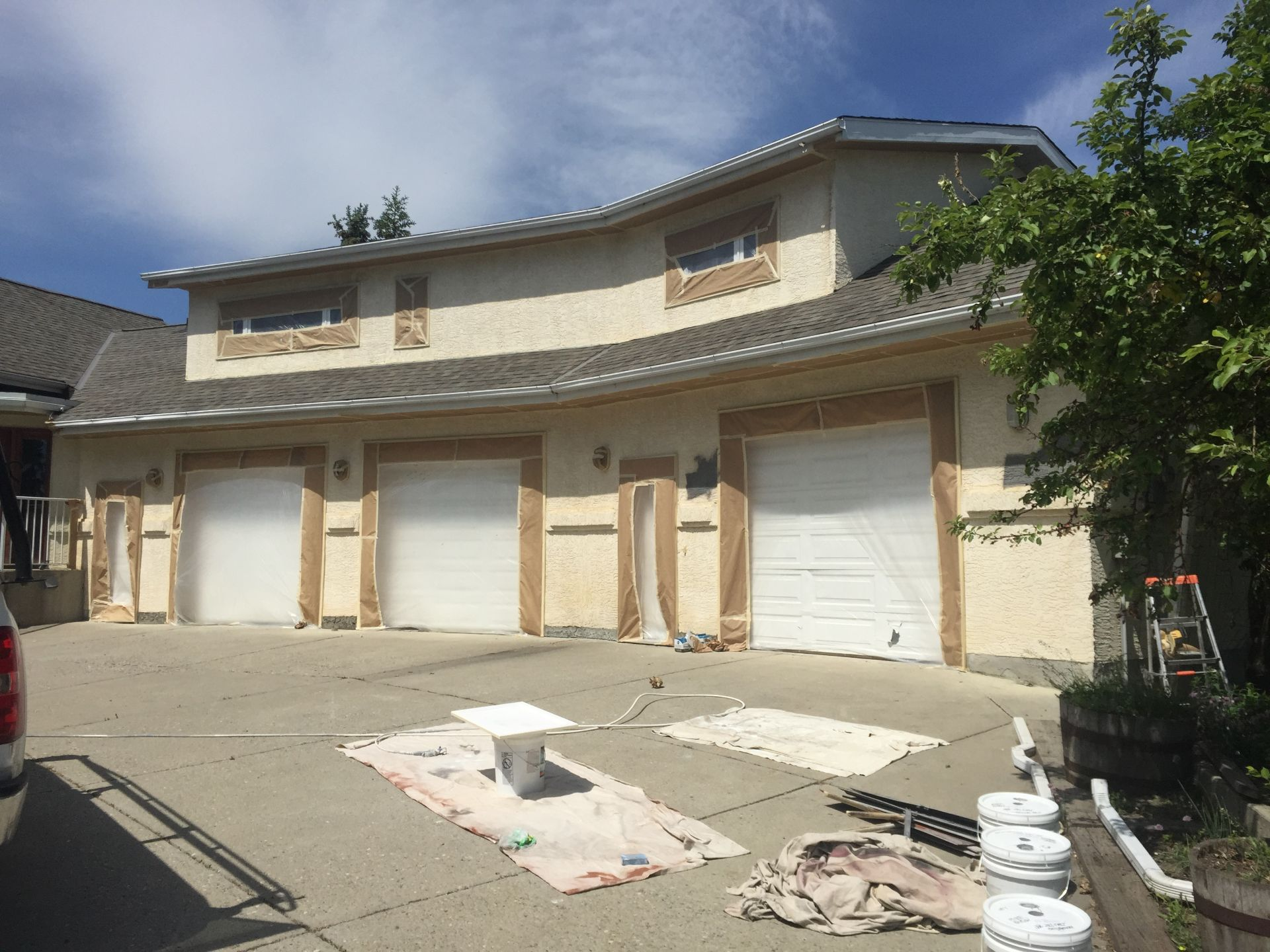 Yellow stucco house before