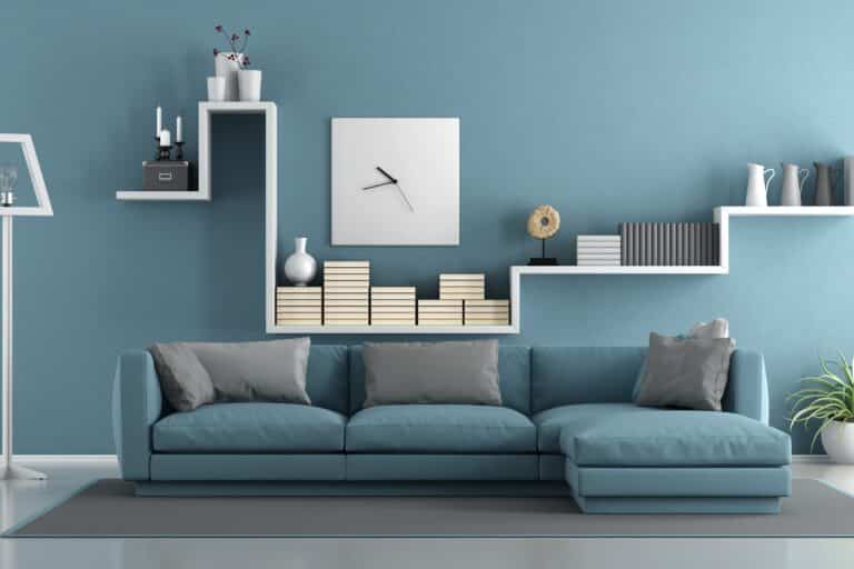 Painting company with a with a blue couch and modern decor